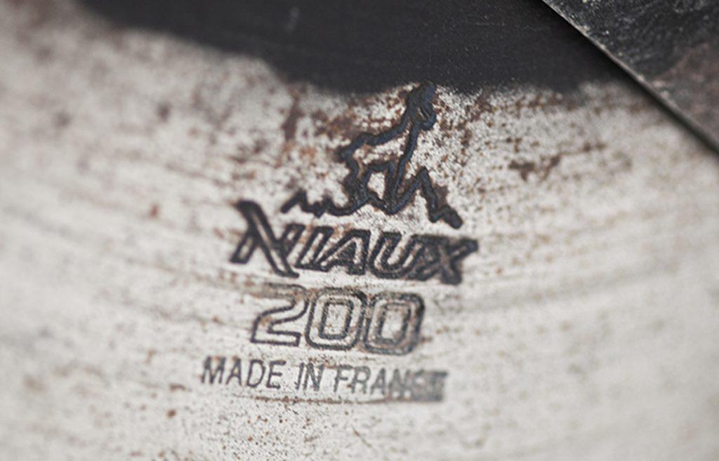 Niaux 200 disc blade logo